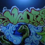 Snake graffiti character with green graffiti piece