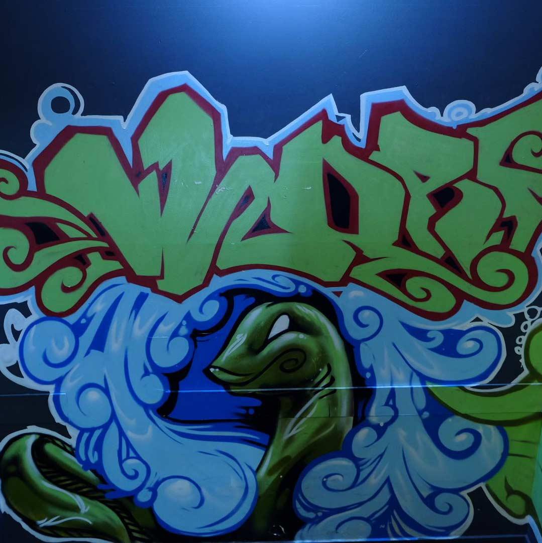 Snake with green graffiti piece